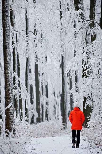 Mature woman in forest in winter snow
