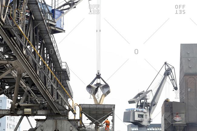 Crane grab transferring goods in port