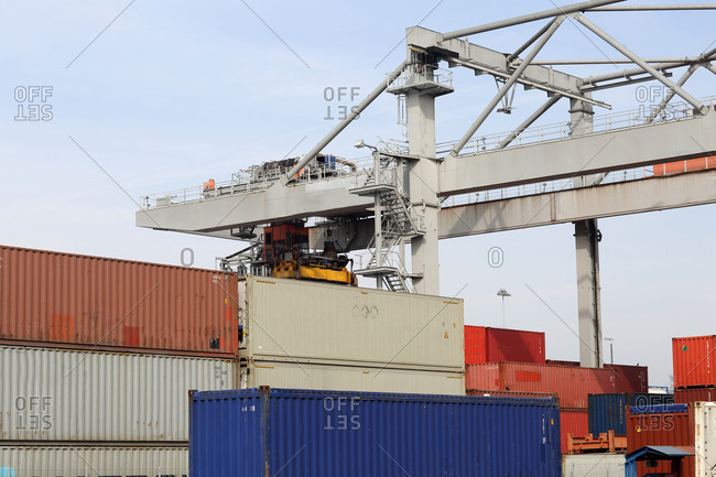 Container crane and stacks of freight containers in port