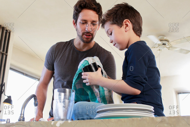 Father and son doing washing up chores