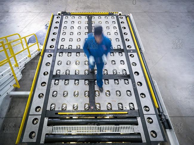 Engineer inspects baggage handling truck in truck repair factory