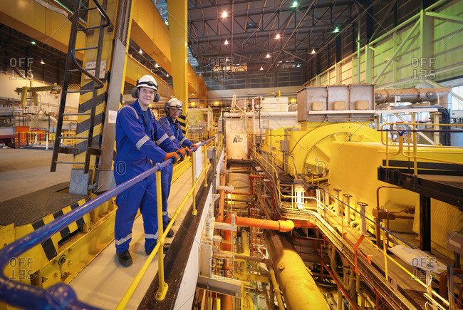 Portrait of workers in turbine hall of power station
