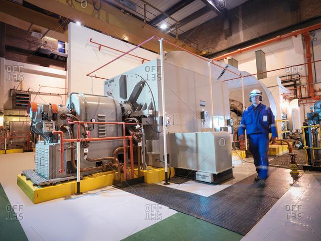 Engineer in generator room of power station