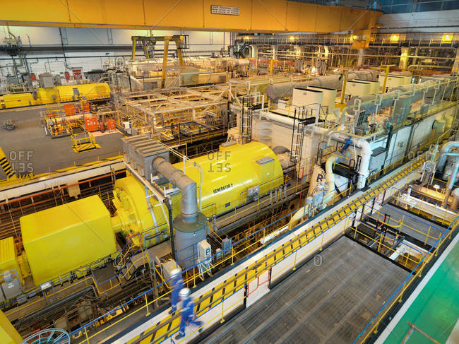 High angle view of workers in turbine hall of power station
