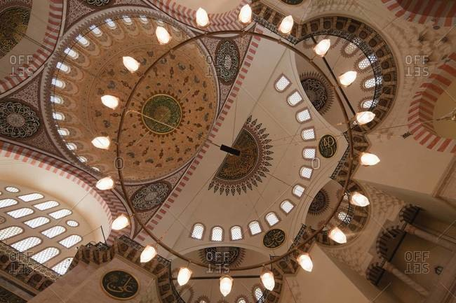 Istanbul, Turkey - May 17, 2011: Low angle view of ornate lighting in Blue Mosque