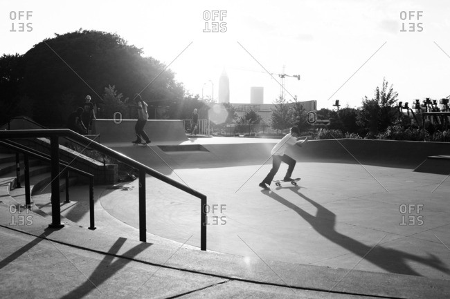 May 6, 2016: Teenagers skateboarding in a public skate park