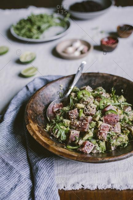 Wood bowl with sesame seared and crusted tuna salad