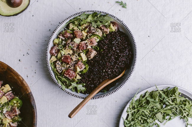 A bowl of Sesame Crusted Seared Tuna Salad and forbidden rice