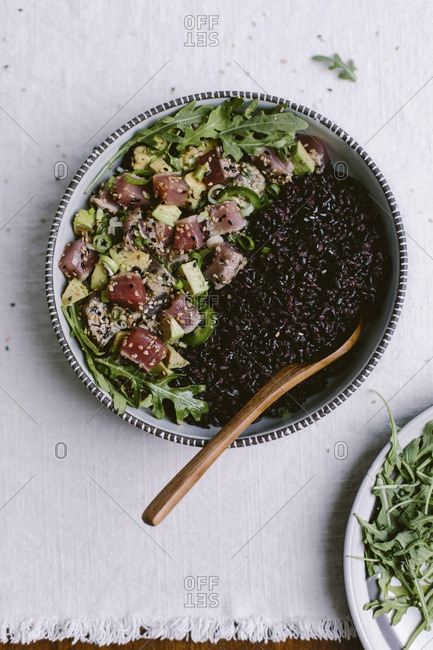 A bowl of Sesame Crusted Seared Tuna Salad and forbidden rice from above