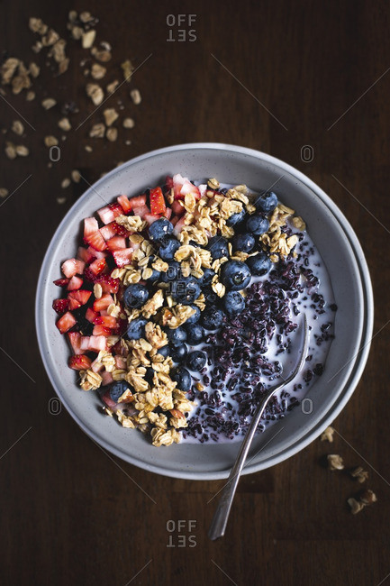 Bowl of forbidden rice morning cereal with berries and granola