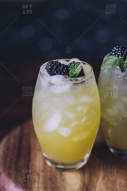 Glasses with mango and blackberry vodka coolers