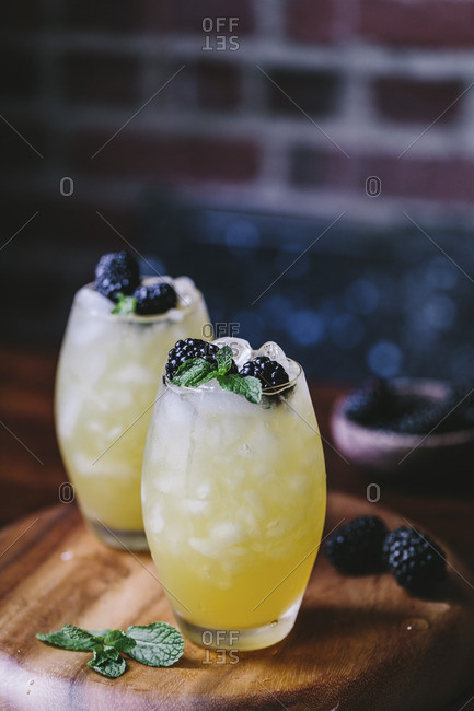 Pair of mango and blackberry vodka coolers