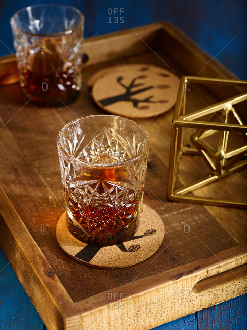 Wood serving tray with two etched glass cocktail tumblers
