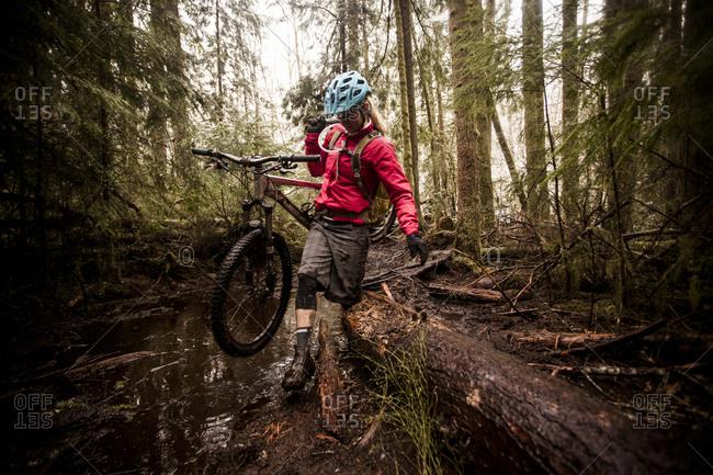 A female mountain biker on a rainy, snowy day in Issaquah, Washington
