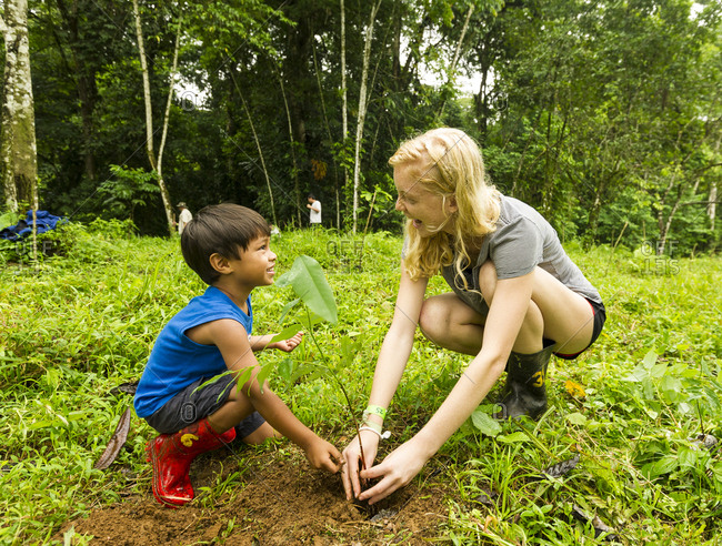 Young girl and boy planting trees in Costa Rica