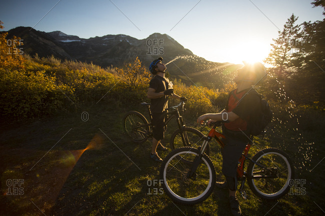 Cyclists goofing around at sunset