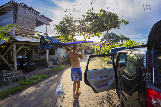 Surfer with a board at morning time