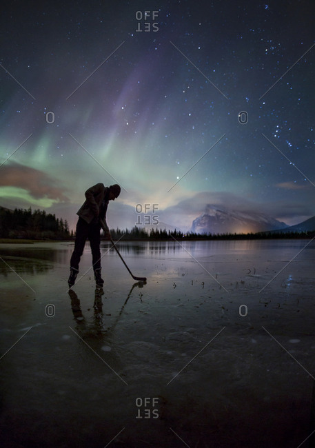 Ice hockey under the aurora