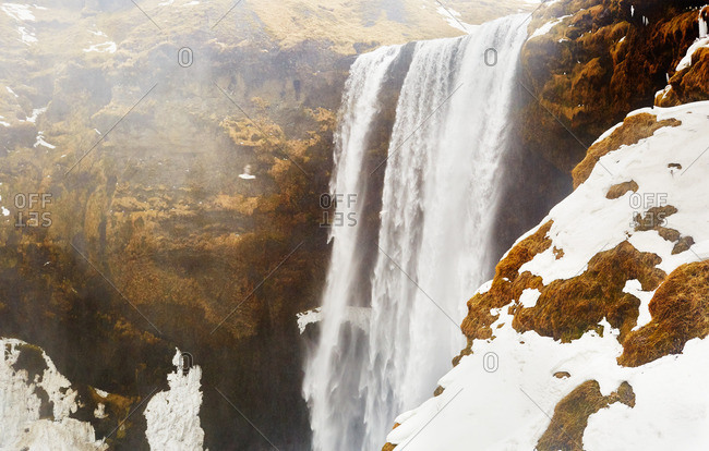 Oxarafoss waterfall with snow in Iceland
