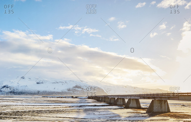 Bridge over tundra at dusk in Iceland
