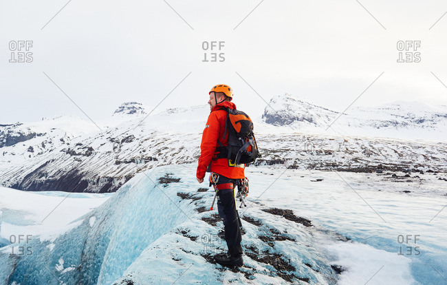February 29, 2016: Mountaineer climbing glacier in Iceland