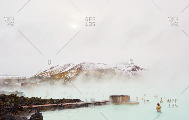 March 1, 2016: People bathing in blue thermal pool in Iceland