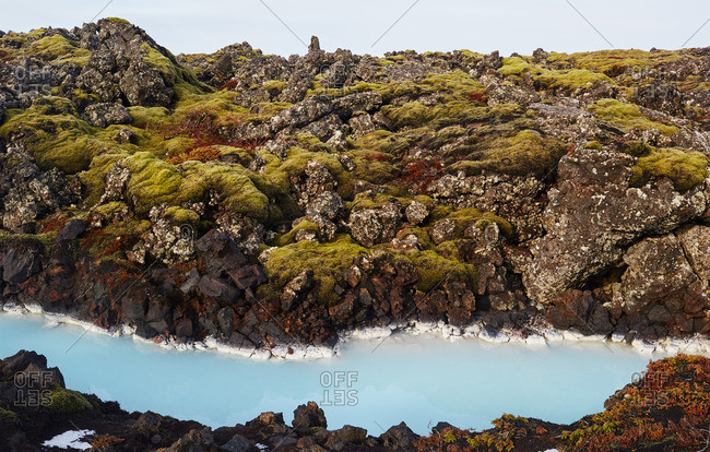 River colored blue with glacial runoff in Iceland