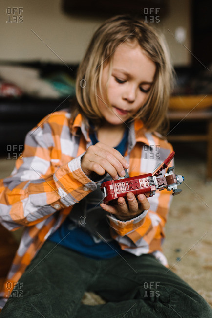 Young child building with toy bricks