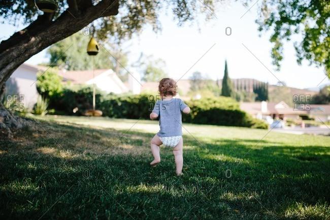 Baby walks on grass
