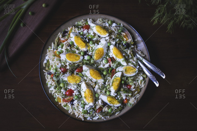 Top view of orzo salad with hard boil eggs