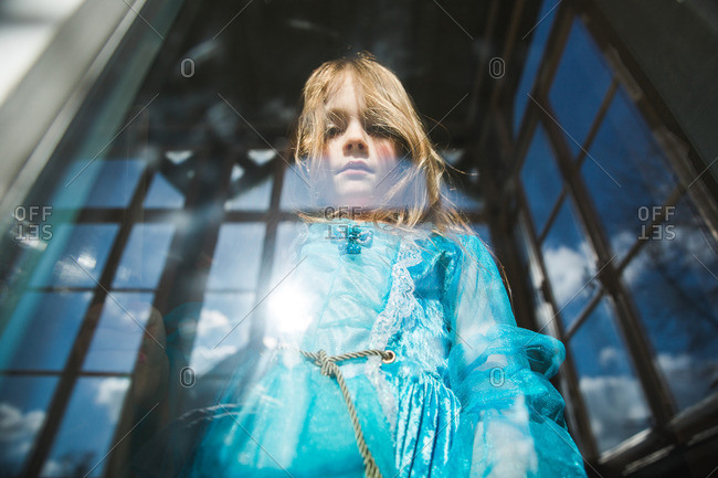 Portrait of a girl standing in a window