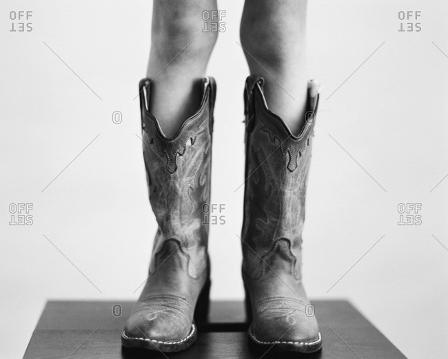 Close up of a girl wearing cowboy boots