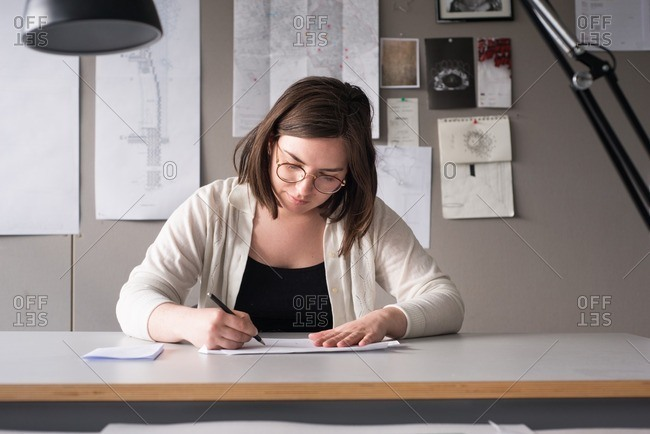 Woman sitting at a drafting table working