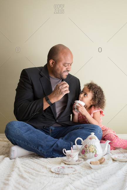Affectionate father and daughter having a tea party