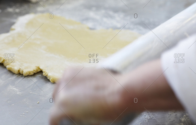 Chef rolling out pastry dough