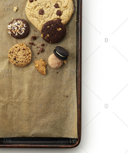 Overhead view of cookies on parchment lined baking tray