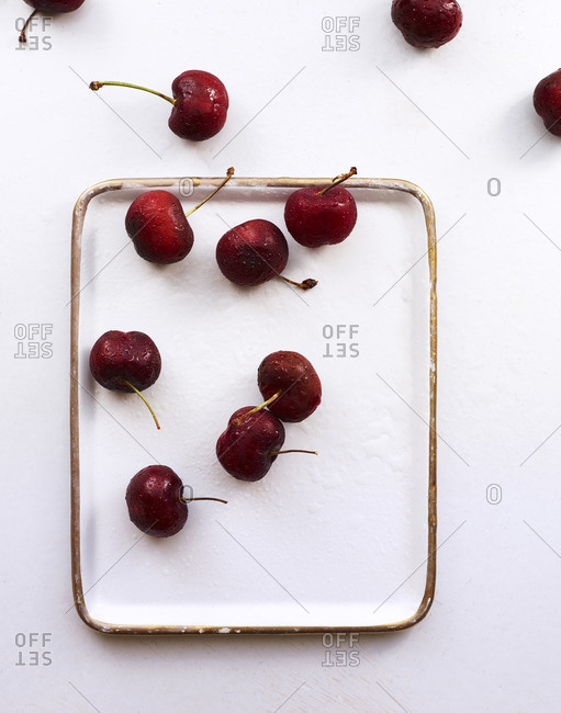 Rectangular plate with fresh cherries