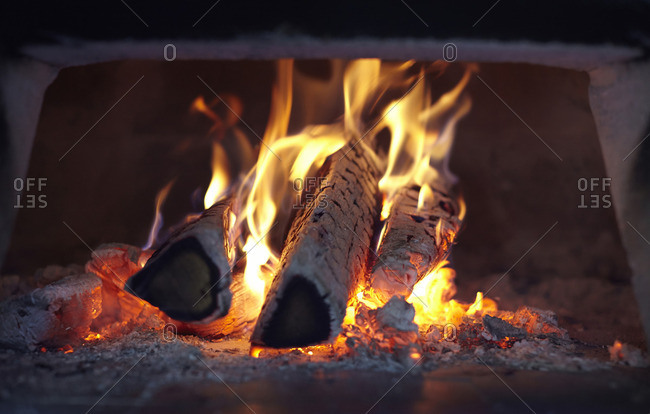Close-up of logs burning in wood oven