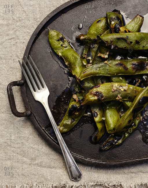 Roasted edamame beans on skillet with fork