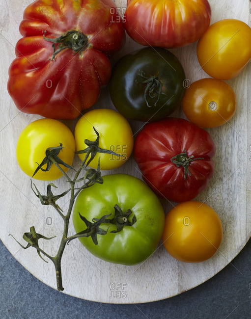 Overhead view of arrangement of fresh heirloom tomatoes