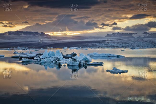 Jokulsarlon lagoon with icebergs and Breidamerkurjokull glacier at sunset