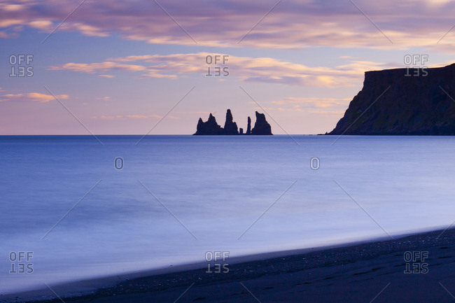 Volcanic rock formations on the coast in the evening