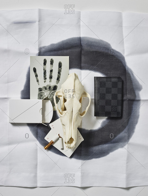 Skull with various items