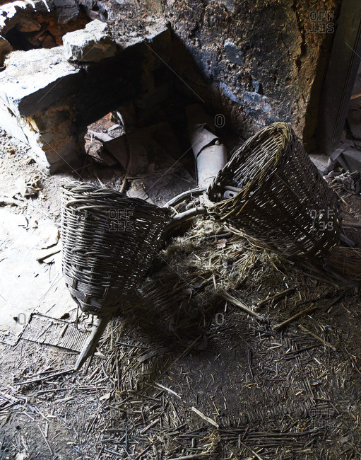 Discarded baskets on ground - Offset