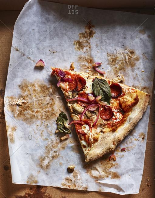Slice of pizza in box
