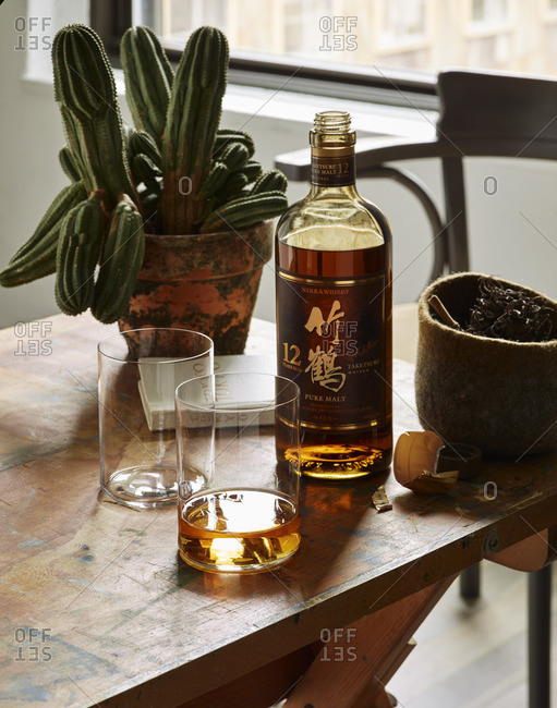 Bottle of whiskey on table