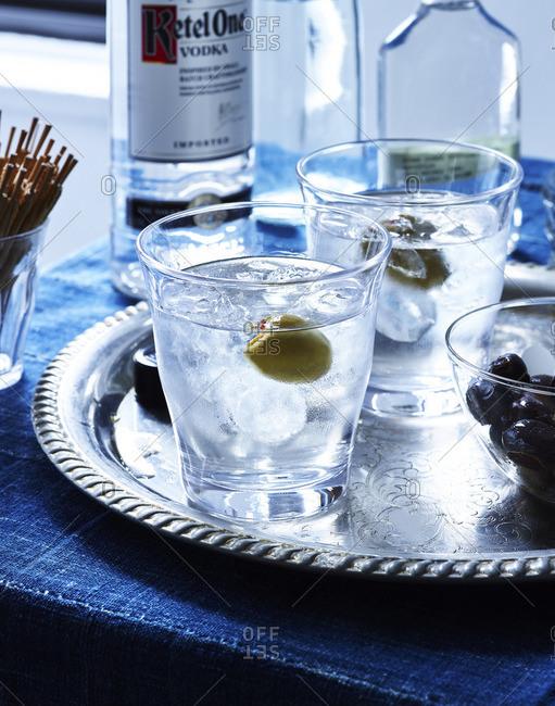 Vodka glasses with olives