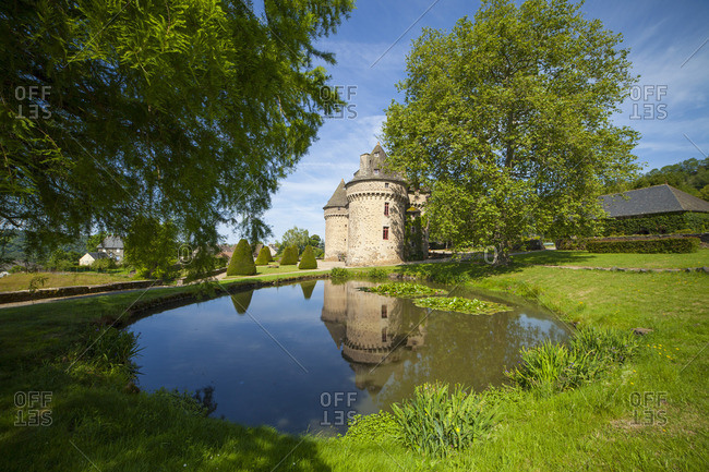 Auzers Castle reflecting in a pond