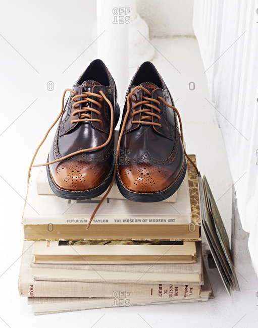Pair of shoes on books