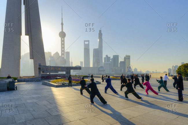 People practicing Tai Chi along the promenade